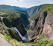The Bjoreia River plunges 182 meters (145 meters direct drop) over Vøringsfossen, Norway's most famous waterfall. Vøringsfossen is in Måbødalen, a valley in the Eidfjord municipality, Hordaland county, Norway. Panorama stitched from 11 overlapping photos.