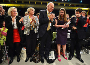 © Licensed to London News Pictures. 26/09/2012. Brighton, UK Business Secretary Vince Cable (centre) applauds Jo Swinson MP (purple dress, pink shoes) during a standing ovation. Jo Swinson MP delivers her speech at the Liberal Democrat Conference at the Brighton Centre in Brighton today 25th September 2012. Photo credit : Stephen Simpson/LNP