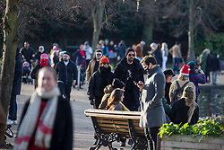 © Licensed to London News Pictures.25/12/2020, London, UK. Members of the public are seen enjoying themselves on the Christmas Day in Victoria Park, east London. Photo credit: Marcin Nowak/LNP