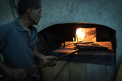6 October 2018, Jericho, Occupied Palestinian Territories: 70-year-old Abu Ayesh bakes early morning bread in his bakery, which is as old as he is himself.