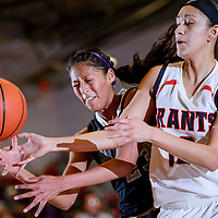 012114       Cable Hoover<br /> <br /> Grants Pirate Eileen Kugler (13) and Miyamura Patriot Amanda Paywa (23) compete for a rebound Tuesday at Grants High School.