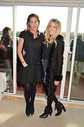 Left to right actress LAURA PRADELSKA and OLIVIA COX at the 2013 Hennessy Gold Cup at Newbury Racecourse, Berkshire on 30th November 2013.