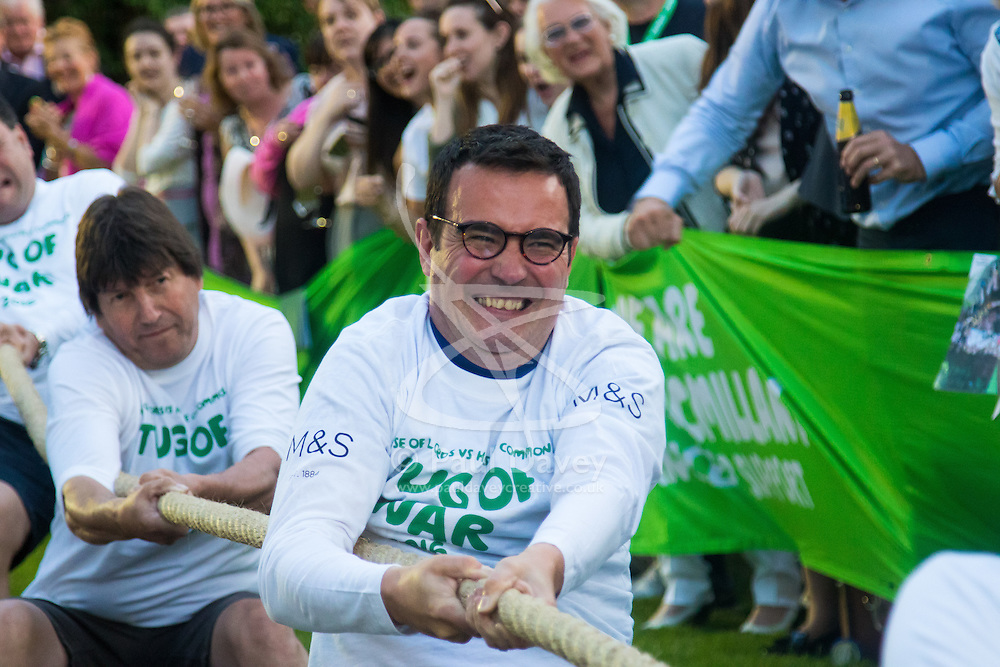 Westminster, London, June 6th 2016. Members of the House of Lords grimace as they try to outdo their MP counterparts as teams from uk industry as well as the House of Commons and the House of Lords compete in the annual McMillan Cancer Charity tug o' war.