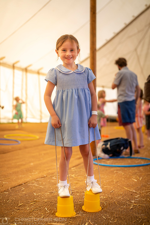 Children learn circus skills at Goodwood Racecourse.<br /> Picture date: Saturday August 28, 2021.<br /> Photograph by Christopher Ison ©<br /> 07544044177<br /> chris@christopherison.com<br /> www.christopherison.com<br /> <br /> IMPORTANT NOTE REGARDING IMAGE LICENCING FOR THIS PHOTOGRAPH: This image is supplied to the client under the terms previously agree. No sales are permitted unless expressly agreed in writing by the photographer.