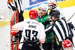 Mirko Djumic of HDD SIJ Acroni Jesenice vs Marc-Oliver Vallerand of HK SZ Olimpija during ice hockey match between HK SZ Olimpija and HDD SIJ Acroni Jesenice in fifth game of Final at Slovenian National League, on May 10, 2021 in Hala Tivoli, Ljubljana, Slovenia. Photo by Matic Klansek Velej / Sportida