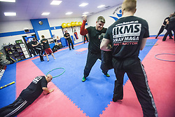 Students punching and doing press-ups. Stef Noij, KMG Instructor from the Institute Krav Maga Netherlands, takes the IKMS G Level Programme seminar today at the Scottish Martial Arts Centre, Alloa.