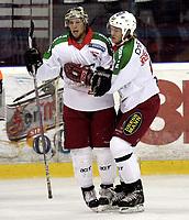 Ishockey<br /> GET-Ligaen<br /> 18.09.07<br /> Jordal Amfi<br /> Vålerenga VIF - Frisk Asker Tigers<br /> Cam Abbott feirer sin 1-2 scoring med Sebastian Skaar<br /> Foto - Kasper Wikestad