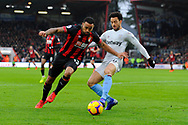 Callum Wilson (13) of AFC Bournemouth bursts in to the box with Felipe Anderson of West Ham challenging him during the Premier League match between Bournemouth and West Ham United at the Vitality Stadium, Bournemouth, England on 19 January 2019.