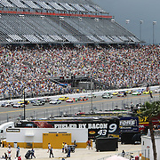 NASCAR Sprint Cup driver Kurt Busch (41) leads the pack down the front stretch during the 56th Annual NASCAR Coke Zero 400 race at Daytona International Speedway on Sunday, July 6, 2014 in Daytona Beach, Florida.  (AP Photo/Alex Menendez)