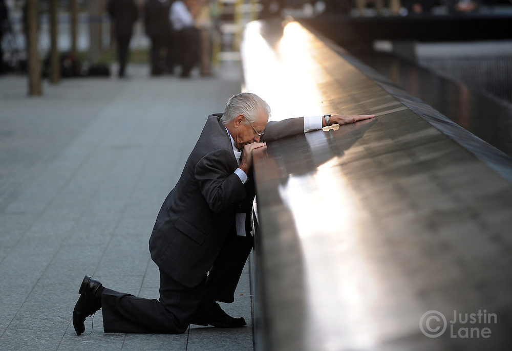 Robert Peraza, who lost his son Robert David Peraza, pauses at his son's name at the North Pool of the 9/11 Memorial during tenth anniversary ceremonies at the site of the World Trade Center September 11, 2011, in New York. POOL/Justin Lane/EPA