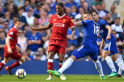 Chelsea's Olivier Giroud (second from right) and Liverpool's Georginio Wijnaldum battle for the ball during the Premier League match at Stamford Bridge, London.