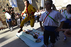June 18, 2017 - Castrillo De Murcia, Burgos, Spain - Castrillo de Murcia, Burgos, Spain. 18th June, 2017. El Colacho, also known as baby jumping, is a traditional Spanish holiday originating back to 1620. It takes place once a year to celebrate the Catholic feast of Corpus Christi in the small town of Castrillo de Murcia. Babies born during the last twelve months are laid on matresses on the ground followed by men dressed as devils jump over them to 'cleanse them of evil spirits' (Credit Image: © M.Ramirez/Pacific Press via ZUMA Wire)