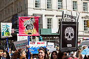 20 September 2019 - New York, NY.  Thousands of students as well as adults gathered in New York for the Global Climate Strike, meeting in Foley Square near the Federal Government buildings and New York's City Hall, and marching downtown to Battery Park, where Swedish climate activist and spokesperson Greta Thunberg addressed the crowd. Marchers bearing signs march down Broadway towards Battery Park.