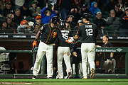 San Francisco Giants center fielder Denard Span (2) and San Francisco Giants second baseman Joe Panik (12) celebrate a run against the Oakland Athletics at AT&T Park in San Francisco, California, on March 30, 2017. (Stan Olszewski/Special to S.F. Examiner)