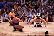 Hakuho performs the Yokuzuna ring-entering ceremony ahead of these wrestlers' bouts in the controversial Nagoya summer Grand Sumo Tournament held on the 14th and second final day.