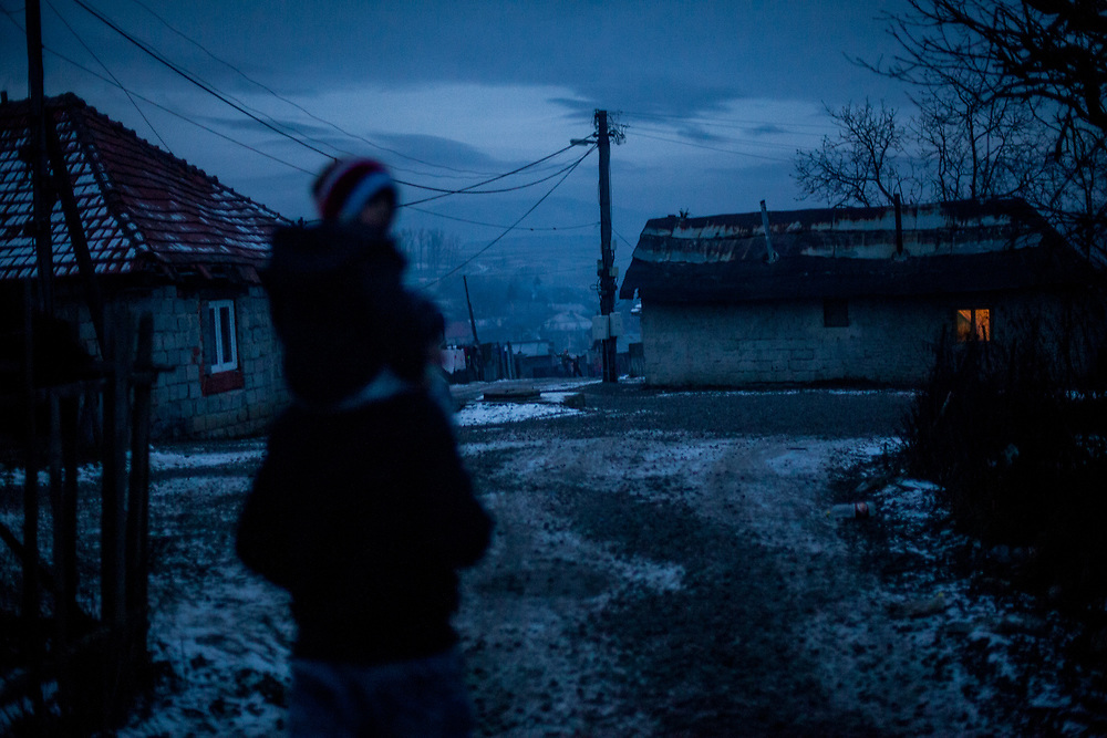 Emil walking with his daughter in the evening light in the Roma part at the village of Rankovce in Slovakia. The foundation ETP Slovakia is working in Rankovce and setting up micro-loan funds for the local Roma community. Self-construction helps to demolish stereotyped views about people from socially excluded communities, whom the majority population regards as abusers of social benefits, socially dependent, incapable, passive and constantly reliant upon state assistance. The approach gives people the opportunity to take care of themselves. In the Roma community are living 272 children (2014)  aged between 0-16 years.