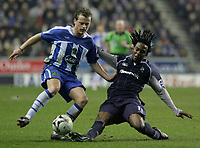 Photo: Dave Howarth.<br /> Wigan Athletic v Bolton Wanderers. Carling Cup.<br /> 20/12/2005.  Wigan's Alan Mahon battles with Bolton's Ricardo Gardiner