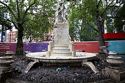 © Licensed to London News Pictures.19/06/2021. London, UK . Large quantities of litter have been left at the Statue of William Shakespeare in Leicester Square after hundreds of Scottish and English football fans gathered ahead of of the England Vs Scotland match last night. The match was part of the 2020 European Football Championship. Photo credit: George Cracknell Wright/LNP