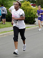Middletown, New York - A runner listens to music on an MP3 player while racing to the finish line in the 15th annual Ruthie Dino Marshall 5K Run and Fun Walk hosted by the Middletown YMCA on Sunday, June 5, 2011.