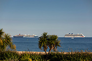 P&O Cruises' largest ship, Britannia (right), at anchor in Weymouth Bay. Cunard's Queen Mary 2 is far left with Tui's Marella Discovery in the centre. The cruise industry has suffered a complete shutdown during the covid-19 pandemic and many vessels are currently waiting at various anchorages around the coast of Great Britain and the world.<br /> Picture date Tuesday 1st September, 2020.<br /> Picture by Christopher Ison. Contact +447544 044177 chris@christopherison.com