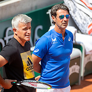 PARIS, FRANCE May 27. Apostolos Tsitsipas and Patrick Mouratoglou, coaches of Stefanos Tsitsipas of Greece watching him practice against Dominic Thiem of Austria on Court Suzanne Lenglen in preparation for the 2021 French Open Tennis Tournament at Roland Garros on May 27th 2021 in Paris, France. (Photo by Tim Clayton/Corbis via Getty Images)