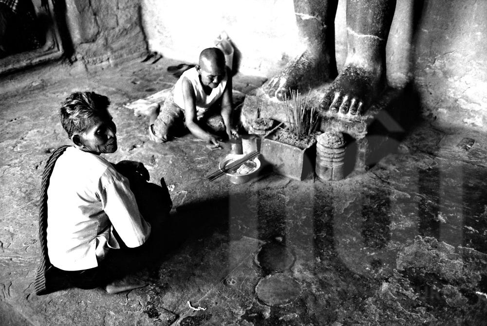 Two old cambodian women prepair encense sticks for praises in Angkor Wat, Cambodia, Asia.