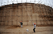 JINGTAI, CHINA - JUNE 20: (CHINA OUT) <br /> <br /> City inside 12 meter high walls<br /> <br /> Workers set up scaffolding to strengthen the city wall of the Yongtai Acient City on June 19, 2015 in Jingtai County, Gansu Province of China. The Yongtai Ancient City, also known as the Turtle city, was built in 1608 during the Ming Dynasty (1368-1644). With a perimeter of 1,717 meters, the city wall is 12 meters in height. The city also has a six-meter wide and one-to-2.5-meter deep moat. In 2006, the city was listed as the sixth batch of nation key cultural relic preservation organ. There are more than 100 villagers still living in the city.<br /> ©Exclusivepix Media