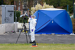 © Licensed to London News Pictures. 22/09/2019. SLOUGH, UK.  A forensics team member at work next to a skate park near one of two forensics tents at Salt Hill Park in Slough, Berkshire, where it is reported a 15 year old boy was fatally stabbed after an altercation with another male.  Emergency services attended the scene at 6.30pm on the evening of 21 September where the boy was pronounced dead.  Investigations are ongoing.  Photo credit: Stephen Chung/LNP