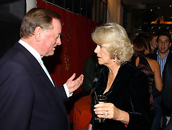 ANDREW PARKER BOWLES and HRH THE DUCHESS OF CORNWALL at a party to celebrate the publication of 'The year of Eating Dangerously' by Tom Parker Bowles held at Kensington Place, 201 Kensington Church Street, London on 12th october 2006.<br />