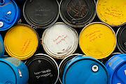 Empty stacked industrial barrels