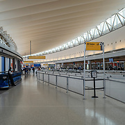 Security lines at the JetBlue terminal at JFK Airport remains sparse during the Phase 4 reopening on Wednesday August 5, 2020 in New York, New York. Mayor de Blasio is asking travelers from 34 states and Puerto Rico, where COVID-19 infection rates are high, to quarantine for 14 days after arriving in the city.  (Alex Menendez via AP)