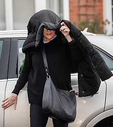© Licensed to London News Pictures. 03/01/2020. London, UK. Emma Langford covers her head with a coat as she arrives at Isleworth Crown Court for sentencing. The 47 year old from Hampshire, faces three charges of assault during a flight from London to Cape Town in December 2018. Photo credit: Peter Macdiarmid/LNP