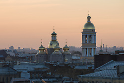 The sun sets over the golden domes of a building in St Petersburg, Russia, on the eve of England's 3rd/4th place World Cup match against Belgium.