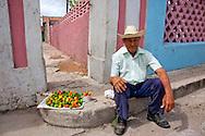 Man selling peppers in Gibara, Holguin, Cuba.