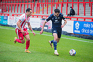 Stevenage forward Elliott List (17) and Morecambe defender Stephen Hendrie (3) battle for the ball during the EFL Sky Bet League 2 match between Stevenage and Morecambe at the Lamex Stadium, Stevenage, England on 6 February 2021.