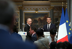 May 29, 2017 - Versailles, FRANCE - French President Emmanuel Macron (L) and his Russian counterpart Vladimir Putin hold a joint press conference at the Chateau de Versailles, west of Paris, on 29 May 2017. It is Putin's first official visit to France since Macron was elected to France's top job. @Maya VIDON-WHITE (Credit Image: © Maya Vidon-White via ZUMA Wire)