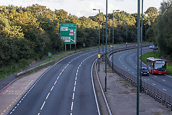 Licensed to London News Pictures. 27/09/2021. Dorking, UK. A very quiet rush hour on the A3 Kingston Bypass south-west London this evening (17:41), a major road in and out of the Capital and usually synonymous with long tailbacks as motorists continue to struggle to find petrol stations with fuel. Large queues have formed at petrol stations across the country over the weekend with many running out of fuel as oil giants struggle to maintain deliveries due to the lack of HGV drivers. Photo credit: Alex Lentati/LNP