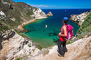 Hiker at Potato Harbor, Santa Cruz Island, Channel Islands National Park, California USA