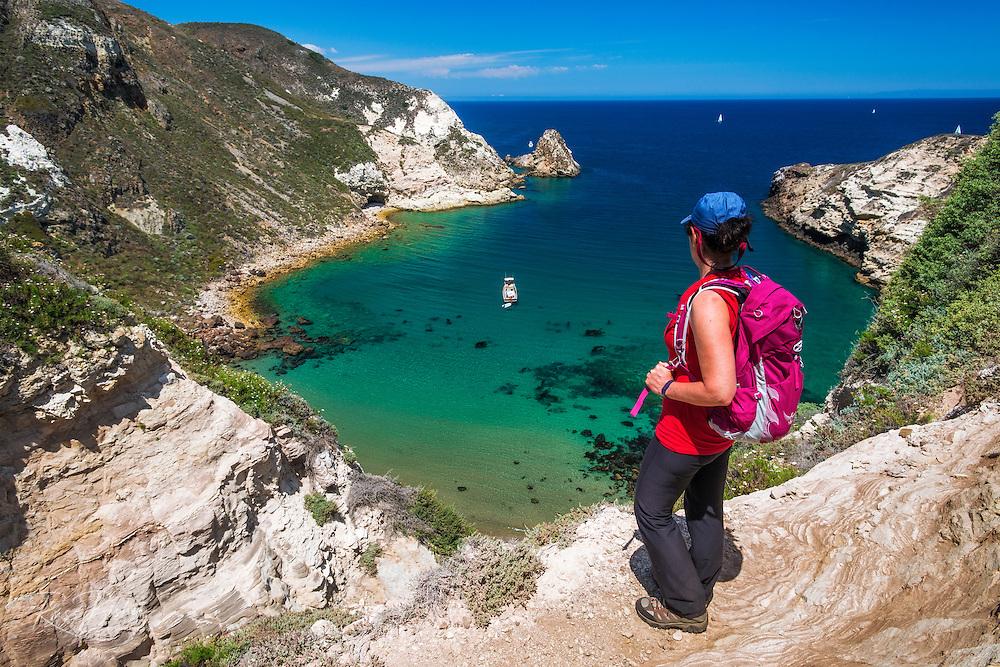 Hiker at Potato Harbor, Santa Cruz Island, Channel Islands National Park, California USA