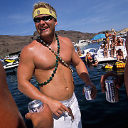 Scott Chamber,  center, and friends drink while partying in Steamboat Cove on Lake Havasu during Memorial Day weekend.