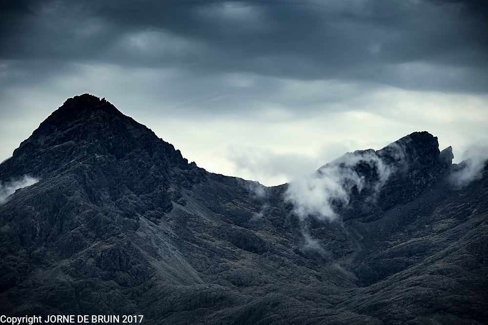 The tops of the Quirang Mountainrange under a dark sky, the Isle of Skye.