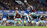 Football - 2017 / 2018 Premier League - Everton vs. Burnley<br /> <br /> Matthew Lowton of Burnley appears to handle the ball in a challenge with Wayne Rooney of Everton at Goodison Park.