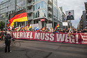"""About 400 participants marched through Berlin's Mitte district as part of the 7th (and last) demonstration under the title """"Merkel Muss Weg"""" (Merkel must go), on September 9, 2017. The marchers, affiliated with the far-right, criticize the German Chancellor's immigration policy throughout her current term, she was also openly hackled by members of the same movement in an election campaign stop in southern Germany that same week."""