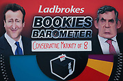 Betting board on College Green outside parliament on the day the 2010 General Election is called. Bookmaker Ladbrokes is offering election odds for all of the main parties.