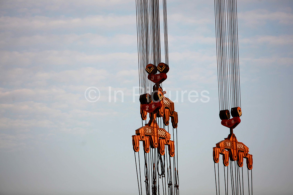 A view of a gantry crane's cables and pulleys at the China State Shipbuilding Corp.'s (CSSC) Longxue Shipyard in Guangzhou, Guangdong Province, China, on Sunday, Nov. 13, 2011. China is the world's biggest shipbuilder, however recent economic downturns have caused a glut in supplies.