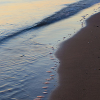 Waves hitting the beach at sunrise, Calvert Cliffs State Park, Lusby, Maryland