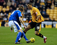 Photo: Leigh Quinnell.<br /> Wolverhampton Wanderers v Leicester City. Coca Cola Championship. 09/12/2006. Wolves' Jay Bothroyd looks for a way past Leicesters Gareth McAuley.