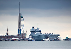 © Licensed to London News Pictures. 16/11/2019. Portsmouth, UK. HMS Prince of Wales, sister aircraft carrier of HMS Queen Elizabeth, sails into its home port of Portsmouth for the first time. The Royal Navy's  latest aircraft carrier sailed from Rosyth dockyard to begin sea trials in September. The ship, which is 280 metres long and weighs 65,000 tonnes, is expected to commission into the Royal Navy in 2020. Photo credit: Peter Macdiarmid/LNP