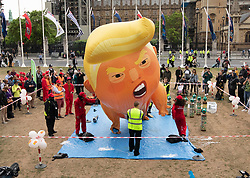 © Licensed to London News Pictures. 04/06/2019. London, UK. An inflatable blimp depicting President Trump as a baby in a nappy is inflated on Parliament Square. On the 2nd day of President Trump's State Visit to the UK he is meeting outgoing Prime Minister Theresa May before attending 75th Anniversary of D-Day commemorations in Portsmouth and France tomorrow. Photo credit: Peter Macdiarmid/LNP