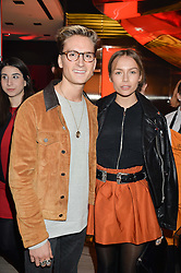 OLIVER PROUDLOCK and EMMA LOUISE CONNOLLY at the launch of the new Ferrari 488 Spider held at Watches of Switzerland, 155 Regent Street, London on 25th February 2016.